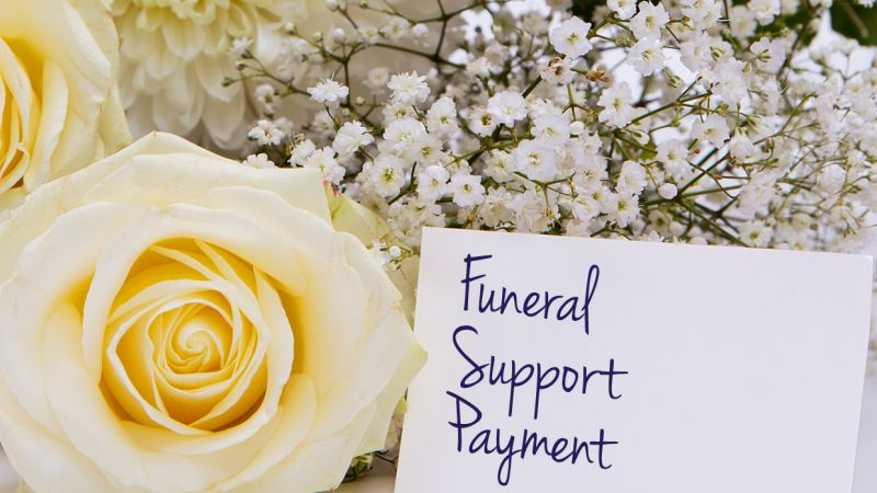 flowers with card that reads funeral support payment